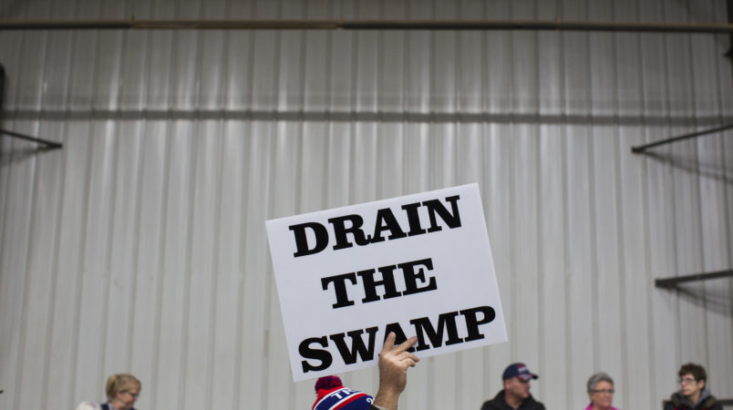 "FILE - In this Oct. 27, 2016, file photo, supporters of then-Republican presidential candidate Donald Trump hold signs during a campaign rally in Springfield, Ohio. President-elect Donald Trump's campaign promise to ""drain the swamp"" of Washington might make it difficult for him to fill all the jobs in his administration. (AP Photo/ Evan Vucci, file)"