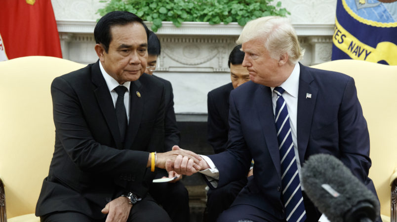 President Donald Trump shakes hands with Thai Prime Minister Prayut Chan-ocha during a meeting in the Oval Office of the White House, Monday, Oct. 2, 2017, in Washington. (AP Photo/Evan Vucci)
