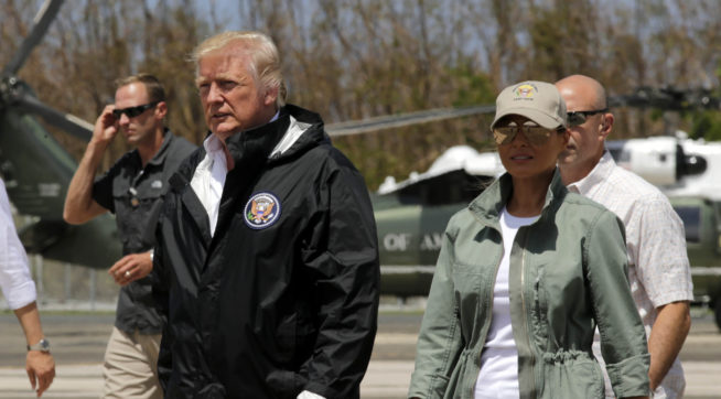President Donald Trump and first lady Melania Trump walk after arrival at the Luis Muñiz Air National Guard Base in San Juan, Puerto Rico, Tuesday, Oct. 3, 2017. Trump is visiting Puerto Rico in the wake of Hurricane Maria.(AP Photo/Ramon Espinosa)