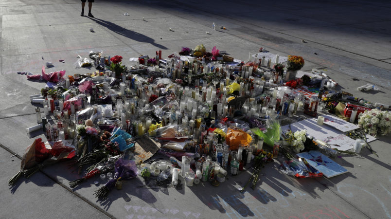 A man pauses at a memorial for the victims of a mass shooting in Las Vegas, Wednesday, Oct. 4, 2017, in Las Vegas. (AP Photo/Marcio Jose Sanchez)