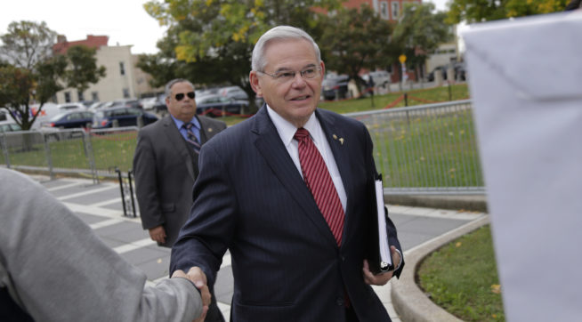 "New Jersey Senator Robert Menendez greets supporters as he arrives to court in Newark, N.J., Monday, Oct. 16, 2017. The judge in Menendez's corruption trial could rule on Monday to dismiss the bulk of the indictment against the New Jersey Democrat, a decision that prosecutors say could ""broadly legalize pay-to-play politics."" (AP Photo/Seth Wenig)"