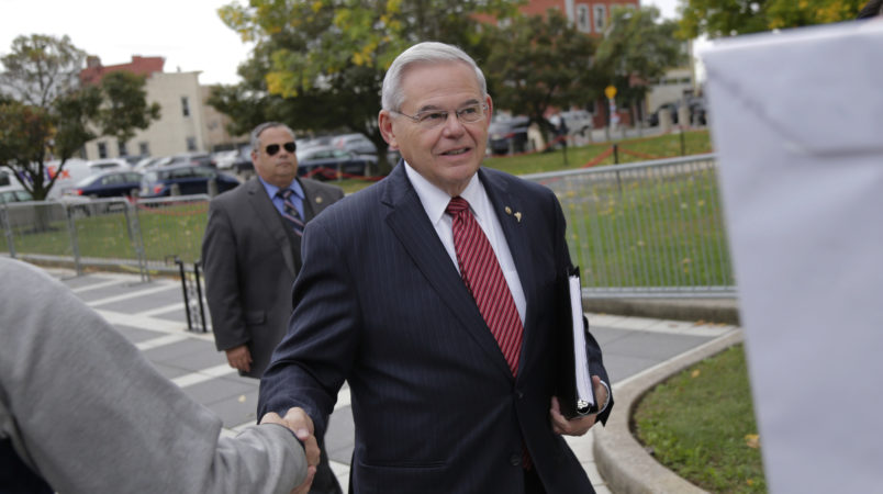 """New Jersey Senator Robert Menendez greets supporters as he arrives to court in Newark, N.J., Monday, Oct. 16, 2017. The judge in Menendez's corruption trial could rule on Monday to dismiss the bulk of the indictment against the New Jersey Democrat, a decision that prosecutors say could """"broadly legalize pay-to-play politics."""" (AP Photo/Seth Wenig)"""