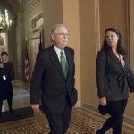 Senate Majority Leader Mitch McConnell, R-Ky., joined at right by Secretary for the Majority Laura Dove, walks from his office to the chamber for the start of the legislative day, at the Capitol in Washington, Tuesday, Oct. 17, 2017. Monday, President Donald Trump and Mitch McConnell reaffirmed their alliance of necessity in a raucous Rose Garden news conference that also underscored their sharp differences. (AP Photo/J. Scott Applewhite)