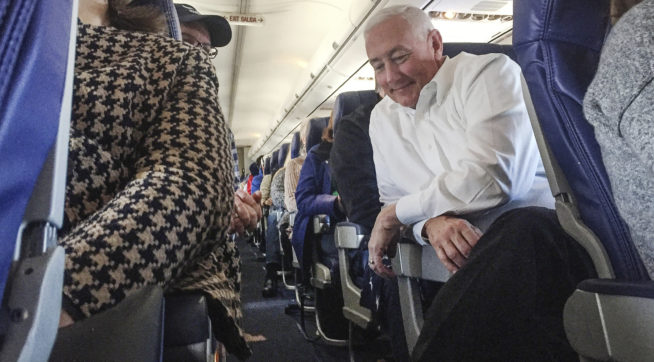 Gregory Pence, brother of Vice President-elect Mike Pence, finds a moment of peace on his flight from Indianapolis to Washington, D.C. on Wednesday, Jan. 18, 2017.