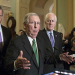 Senate Majority Leader Mitch McConnell, R-Ky., flanked by Sen. John Thune, R-S.D., left, and Majority Whip John Cornyn, R-Texas, announces to reporters that the Senate is moving ahead on a Republican budget plan, a critical step in President Donald Trump and the party's politically imperative drive to cut taxes and simplify the IRS code, at the Capitol in Washington, Tuesday, Oct. 17, 2017.  (AP Photo/J. Scott Applewhite)