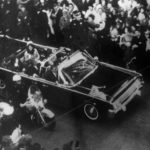 This overhead view of President Kennedy's car in Dallas motorcade on Nov. 22, 1963, was Warren Commission Exhibit No. 698. Special agent Clinton J. Hill is shown riding atop the rear of the limousine. The Warren Commission said agent Hil had to leave the left front running board of the President's follow-up car four times because of dense crowds to ride on the rear of the presidential limousine. (AP Photo)