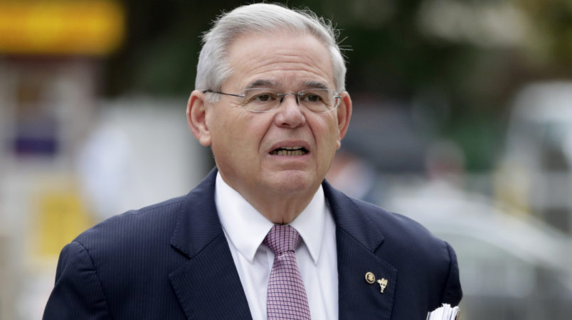 U.S. Sen. Bob Menendez arrives at the Martin Luther King, Jr., Federal Courthouse for his federal corruption trial, Thursday, Oct. 26, 2017, in Newark, N.J. (AP Photo/Julio Cortez)