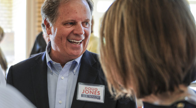 Candidate Doug Jones chats with constituents before a Democratic Senate candidate forum at the Princess Theatre in Decatur, Ala. Thursday, Aug. 3, 2017. (Jeronimo Nisa /The Decatur Daily via AP)