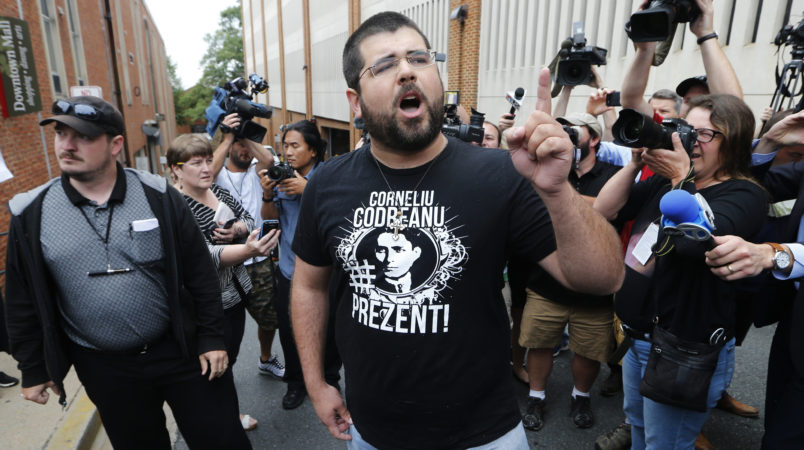 An alt-right supporter, Matthew Heinbach, right, voices his displeasure at the media after a court hearing for James Alex Fields Jr., in front of court in Charlottesville, Va., Monday, Aug. 14, 2017.  (AP Photo/Steve Helber)