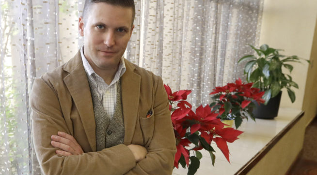 """FILE – In this Dec. 6, 2016, file photo, Richard Spencer, a leader in the """"alt-right"""" that mixes racism, white nationalism and populism, poses between interviews the day of his speech on the Texas A&M University campus in College Station, Texas. A University of Cincinnati spokesman said Thursday, Sept. 28, 2017, that the school was assessing """"safety and logistical considerations"""" in considering white nationalist Richard Spencer's request to speak there, WCPO-TV reports, after Ohio State University and other colleges rejected similar requests. (AP Photo/David J. Phillip, File)"""