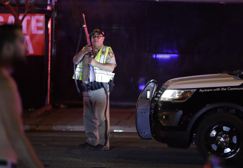 A police officer stands at the scene of a shooting along the Las Vegas Strip, Monday, Oct. 2, 2017, in Las Vegas. (AP Photo/John Locher)