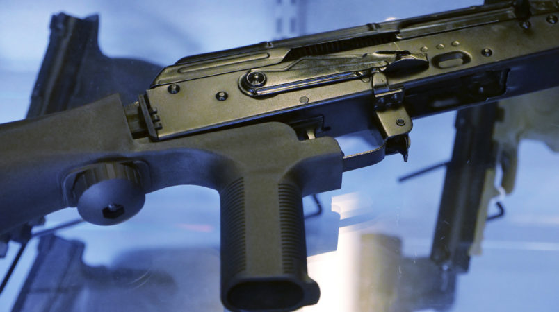 "A little-known device called a ""bump stock"" is attached to a semi-automatic rifle at the Gun Vault store and shooting range Wednesday, Oct. 4, 2017, in South Jordan, Utah. (AP Photo/Rick Bowmer)"