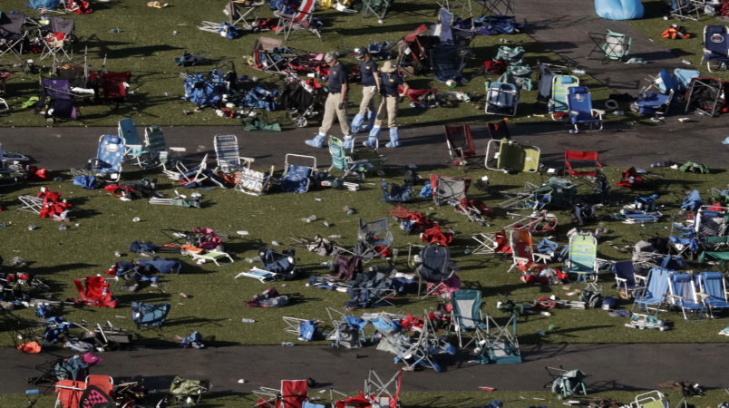Agents from the FBI continue to process evidence at the scene of a mass shooting on Wednesday, Oct. 4, 2017, in Las Vegas. A gunman opened fire on an outdoor music concert on Sunday killing dozens and injuring hundreds. (AP Photo/Gregory Bull)