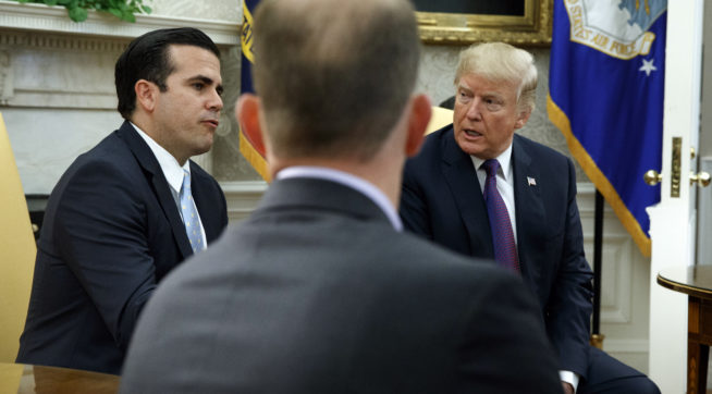 President Donald Trump listens as Governor Ricardo Rossello of Puerto Rico speaks during a meeting in the Oval Office of the White House, Thursday, Oct. 19, 2017, in Washington. (AP Photo/Evan Vucci)