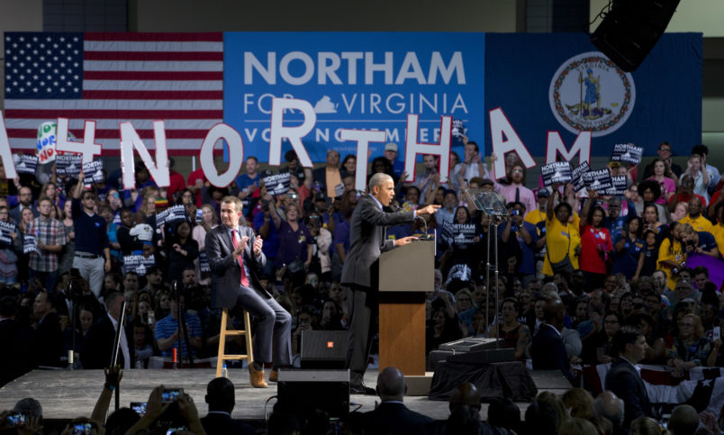Former President Barack Obama, right, gestures during a rally with Democratic gubernatorial candidate Lt. Gov., Ralph Northam, in Richmond, Va., Thursday, Oct. 19, 2017. (AP Photo/Steve Helber)