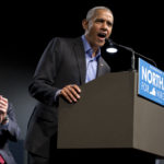Former President Barack Obama, right, waves to the crowd along with Democratic gubernatorial candidate Lt. Gov., Ralph Northam, during a rally in Richmond, Va., Thursday, Oct. 19, 2017.  (AP Photo/Steve Helber)