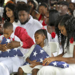 (L to R) Richard Johnson Sr. holds La David Johnson Jr. Ah'Leesya Johnson, and Myeshia Johnson, the wife of Army Sgt. La David Johnson. He was buried at Hollywood Memorial Gardens. Johnson was working with U.S. Army Special Forces in Northwestern Africa when Islamic militants ambushed them on Oct. 4, near the Niger border. Mike Stocker, South Florida Sun-Sentinel...SOUTH FLORIDA OUT; NO MAGS; NO SALES; NO INTERNET; NO TV...