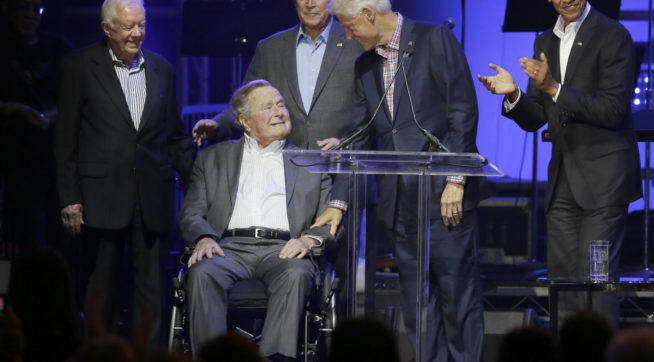 President George HW Bush apologizes for patting women on the rear
