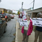 Supporters of the ACA stopped by Rep. Jackie Walorski's office to protest her support repeal and replace Wednesday, Sept. 27, 2017, in Mishawaka, Ind. (Santiago Flores/South Bend Tribune via AP)