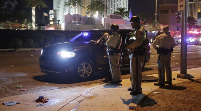 Las Vegas Police stand at the scene of a shooting along the Las Vegas Strip, Monday, Oct. 2, 2017, in Las Vegas. (AP Photo/John Locher)