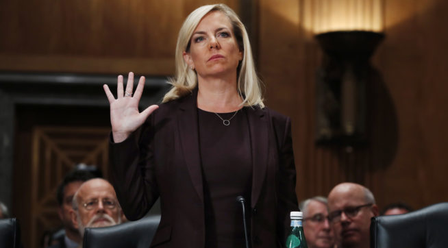 Kirstjen Nielsen is sworn in at a hearing on her nomination to be Department of Homeland Security Secretary, by the Senate Homeland Security and Governmental Affairs committee, Wednesday, Nov. 8, 2017, on Capitol Hill in Washington. (AP Photo/Jacquelyn Martin)