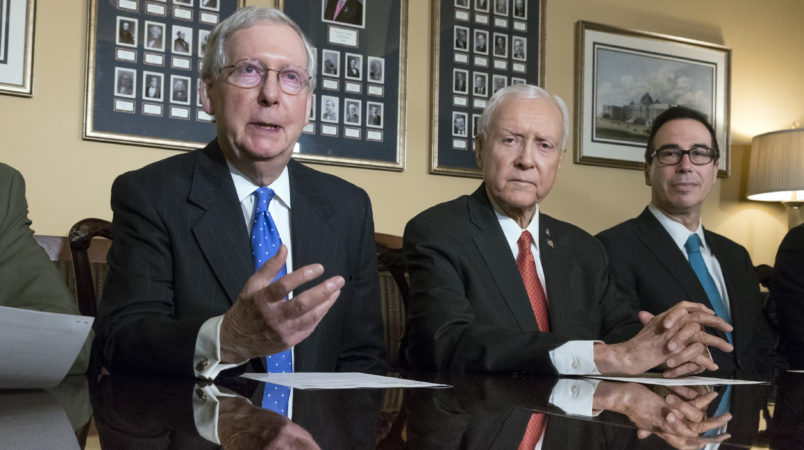 From left, Senate Judiciary Committee Chairman Chuck Grassley, R-Iowa, Senate Majority Leader Mitch McConnell, R-Ky., Senate Finance Committee Chairman Orrin Hatch, R-Utah, and Treasury Secretary Steven Mnuchin, make statements to reporters as work gets underway on the Senate's version of the GOP tax reform bill, on Capitol Hill in Washington, Thursday, Nov. 9, 2017.  (AP Photo/J. Scott Applewhite)