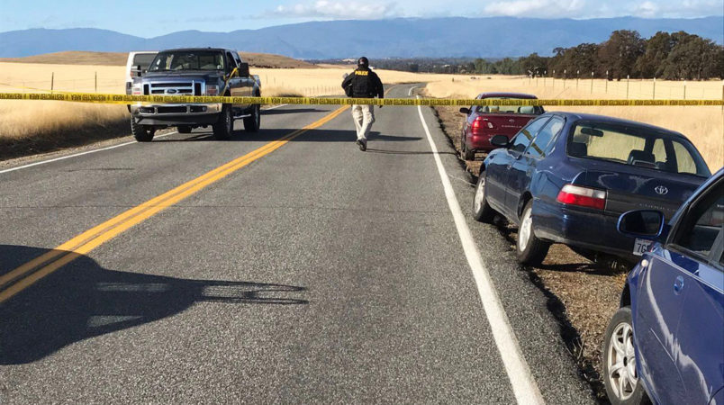 Crime tape blocks off Rancho Tehama Road leading into the Rancho Tehama subdivision about 20 miles south of Red Bluff, Calif., on Tuesday, Nov. 14, 2017. At least three people died and more were injured in a shooting.