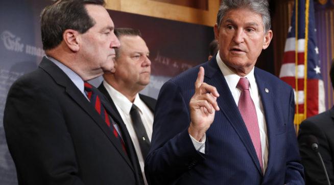 Sen. Joe Manchin, D-W.Va., right, with Sen. Joe Donnelly, D-Ind., left, and Sen. Jon Tester, D-Mont., speaks about tax reform, Tuesday, Nov. 28, 2017, on Capitol Hill in Washington. (AP Photo/Jacquelyn Martin)