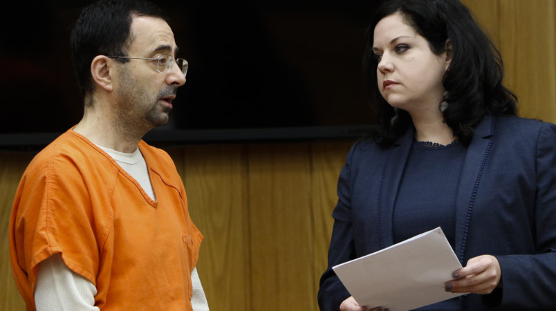 Former gymnastics doctor Larry Nassar pleads guilty to three counts of first-degree criminal sexual conduct Wednesday, Nov. 29, 2017, in Judge Janice Cunningham's courtroom in Eaton County.  Also pictured is his attorney Shannon Smith.
