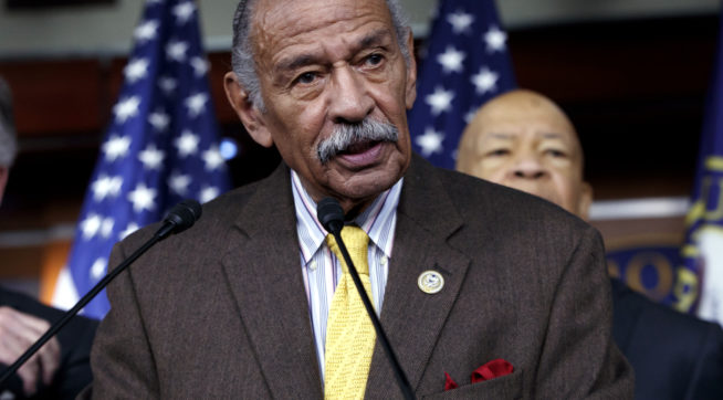FILE -- In this file photo from Tuesday, Feb. 14, 2017, Rep. John Conyers, D-Mich., center, flanked by Rep. Richard Neal, D-Mass., left, and Rep. Elijah Cummings, D-Md., says they want an investigation into President Donald Trump's relationship with Russia, on Capitol Hill in Washington. Top House Democrat Nancy Pelosi said today, Thursday, Nov. 30, 2017, that Rep. Conyers, should resign in the face of multiple accusations of sexual misconduct, calling them serious, disappointing and very credible.    (AP Photo/J. Scott Applewhite, file)