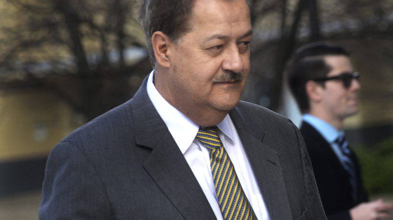 FILE - In a Wednesday, April 6, 2016, file photo, former Massey CEO Don Blankenship is escorted by Homeland Security officers from the Robert C. Byrd U.S. Courthouse in Charleston, W. Va. Attorneys for Blankenship and the federal government head to court this week in the ex-coal operator's appeal of his conviction in connection with the deadliest U.S. mine disaster in four decades. Oral arguments are scheduled for Wednesday, Oct. 26, before a three-judge panel at the 4th U.S. Circuit Court of Appeals in Richmond, Va. (F. Brian Ferguson/Charleston Gazette-Mail via AP, File)