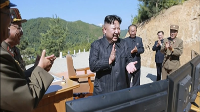 ** LET'S CHECK AND SEE IF WE HAVE KNS VERSION OF THIS PHOTO ** This image made from video of a news bulletin aired by North Korea's KRT on Tuesday, July 4, 2017, shows what was said to be North Korea leader Kim Jung Un, center, applauding after the launch of a Hwasong-14 intercontinental ballistic missile (ICBM) in North Korea's northwest. Kim Jong Un has something his father and grandfather could only dream of, an intercontinental ballistic missile capable of striking the United States with a nuclear weapon. Independent journalists were not given access to cover the event depicted in this photo.  (KRT via AP Video, File)