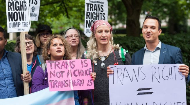 Trump blocked by federal judge from delaying transgender troops from enlisting