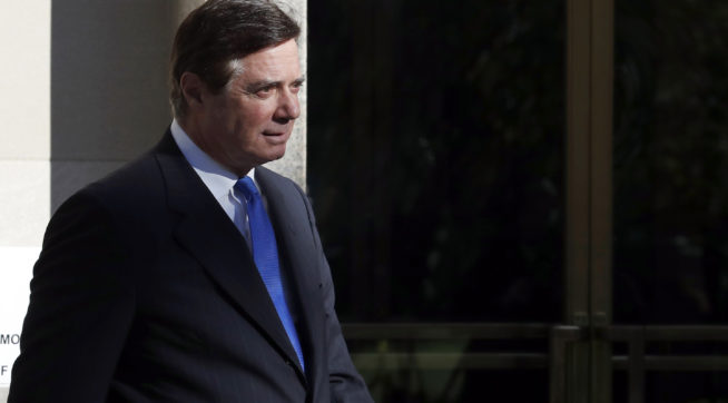 Paul Manafort, President Donald Trump's former campaign chairman, departs Federal District Court in Washington, Monday, Oct. 30, 2017. Manafort, and a former business associate, Rick Gates, have been told to surrender to federal authorities Monday, according to reports and a person familiar with the matter. (AP Photo/Alex Brandon)