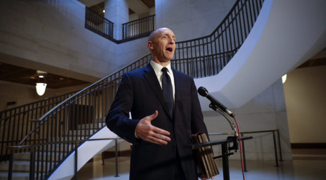Carter Page, a foreign policy adviser to Donald Trump's 2016 presidential campaign, speaks with reporters briefly following a day of questions from the House Intelligence Committee, on Capitol Hill in Washington, Thursday, Nov. 2, 2017. (AP Photo/J. Scott Applewhite)
