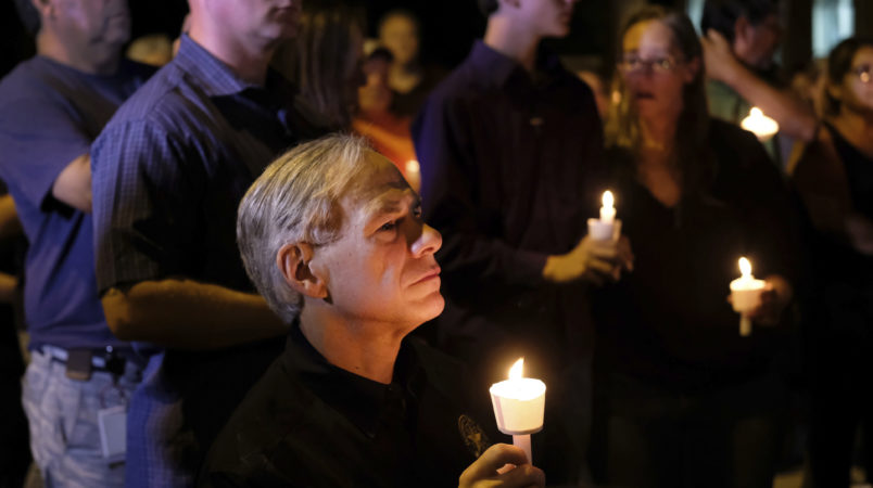 Texas Governor Greg Abbott attended a candlelight vigil in Sutherland Springs, Texas on Sunday, November 5, 2017 after a shooter opened fire on a church and killed 26 people. Photo by Laura Skelding