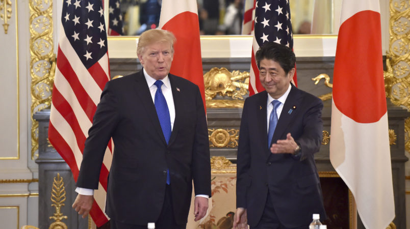 US President Donald Trump (L) is led by Japanese Prime Minister Shinzo Abe (R) before a summit meeting at Akasaka Palace in Tokyo on November 6, 2017. / AFP PHOTO / POOL / Kazuhiro NOGI /// Attn photo desk (AFP POOL-Trump/Abe summit meeting-7) Herewith AFP POOL photo, 110607F. 110607F: US President Donald Trump (L ) is led by Japanese Prime Minister Shinzo Abe (R ) before a summit meeting at Akasaka Guest House in Tokyo on November 6, 2017. AFP PHOTO / POOL / Kazuhiro NOGICheers, Nogi/tokpix