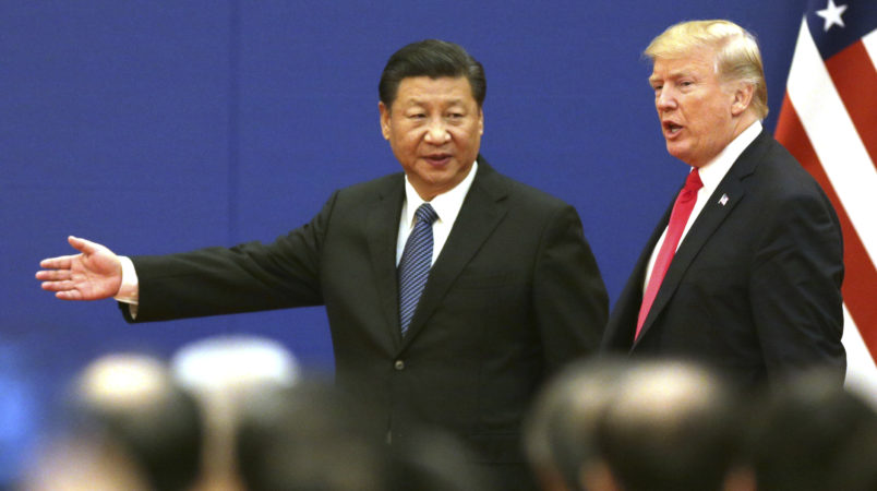 U.S. President Donald Trump (R) and China's President Xi Jinping attend a signing ceremony of US-China Business Exchange at the Great Hall of the People in Beijing on Nov. 9, 2017.( The Yomiuri Shimbun via AP Images )