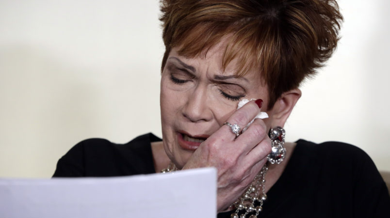 Beverly Young Nelson the latest accuser of Alabama Republican Roy Moore, reads her statement at a news conference, in New York, Monday, Nov. 13, 2017. Nelson says she was a 16-year-old high school student working at a restaurant where Moore was a regular. She says Moore groped her, touched her breasts and locked the door to keep her inside his car. She said he squeezed her neck while trying to push her head toward his crotch and that he tried to pull her shirt off. (AP Photo/Richard Drew)