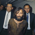 FILE - In this 1969 file photo, Charles Manson is escorted to his arraignment on conspiracy-murder charges in connection with the Sharon Tate murder case. (AP Photo/File)