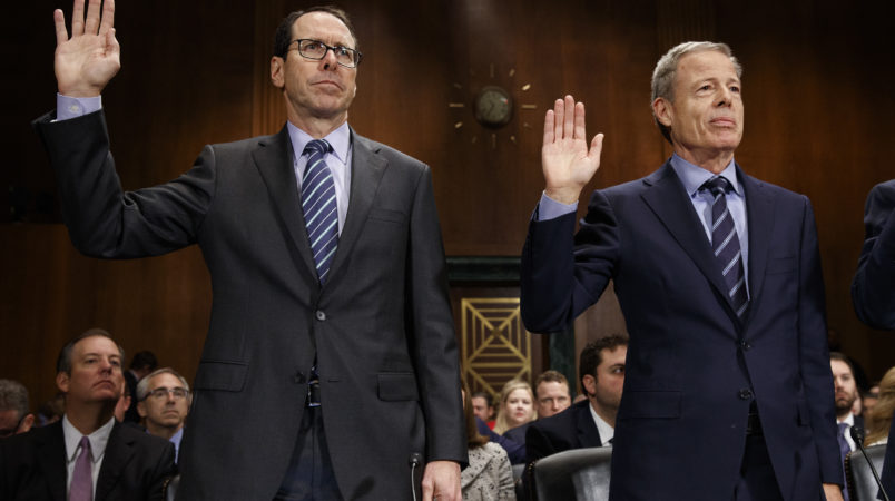 AT&T Chairman and CEO Randall Stephenson, left, and Time Warner Chairman and CEO Jeffrey Bewkes are sworn in during a Senate Judiciary subcommittee hearing on the proposed merger between AT&T and Time Warner, on Capitol Hill, Wednesday, Dec. 7, 2016, in Washington. (AP Photo/Evan Vucci)