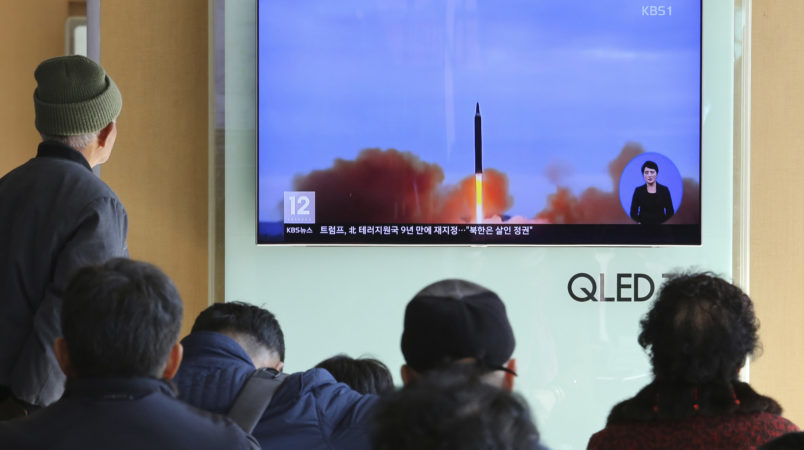 "People watch a TV screen showing a file footage of North Korea's missile launch, at Seoul Railway Station in Seoul, South Korea, Tuesday, Nov. 21, 2017. U.S. President Donald Trump announced Monday the U.S. is putting North Korea's ""murderous regime"" on America's terrorism blacklist, despite questions about Pyongyang's support for international attacks beyond the assassination of its leader's half brother in February. (AP Photo/Ahn Young-joon)"