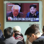 "FILE- In this Tuesday, Nov. 21, 2017, file photo, people watch a TV screen showing images of U.S. President Donald Trump, left, and North Korean leader Kim Jong Un at Seoul Railway Station in Seoul, South Korea. North Korea has called on Wednesday, Nov. 22, 2017,Trump's decision to relist the country as a state sponsor of terrorism a ""serious provocation"" that justifies its development of nuclear weapons. The signs read ""UN sanctions and The blow is not big."" (AP Photo/Ahn Young-joon, File)"