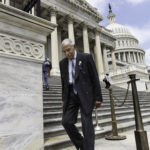 Rep. John Conyers, D-Mich., walks down the steps of the House of Representatives after final votes, at the Capitol in Washington, Friday, May 30, 2014. Michigan election officials announced Friday that they won't appeal a decision that puts the 85-year-old Detroit lawmaker on the August primary ballot. Earlier this month, hundreds of signatures for Conyers' candidacy were disqualified because of voter registration problems. (AP Photo/J. Scott Applewhite)
