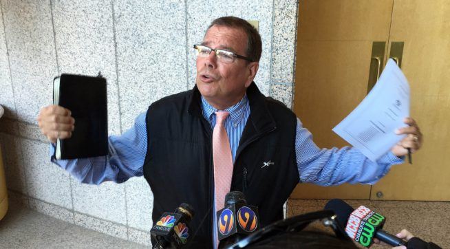 Flip Benham talks to the media about his opposition to the city's anti-discrimination ordinance outside the Meeting Chamber during a break at the Charlotte City Council meeting on Monday, May 23, 2016. The City Council decided to take the discussion of the repeal of the city's anti-discrimination ordinance off the agenda for the meeting.