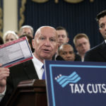 "House Ways and Means Committee Chairman Kevin Brady, R-Texas, joined by Speaker of the House Paul Ryan, R-Wis., right, holds a proposed ""postcard tax filing form"" as they unveil the GOP's far-reaching tax overhaul, the first major revamp of the tax system in three decades, on Capitol Hill in Washington, Thursday, Nov. 2, 2017.  (AP Photo/J. Scott Applewhite)"