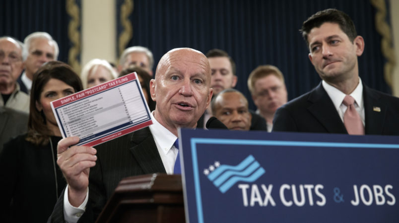 """House Ways and Means Committee Chairman Kevin Brady, R-Texas, joined by Speaker of the House Paul Ryan, R-Wis., right, holds a proposed """"postcard tax filing form"""" as they unveil the GOP's far-reaching tax overhaul, the first major revamp of the tax system in three decades, on Capitol Hill in Washington, Thursday, Nov. 2, 2017.  (AP Photo/J. Scott Applewhite)"""