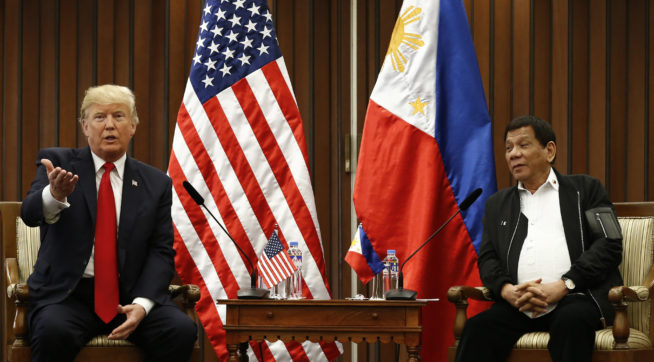 U.S. President Donald J. Trump, left, gestures beside Philippine President Rodrigo Duterte as they hold a bilateral meeting on the sidelines of the 31st Association of Southeast Asian Nations (ASEAN) Summit and Related Meetings at the Philippine International Convention Center in Manila, Philippines on Monday November 13, 2017. (Rolex dela Pena/Pool Photo via AP)