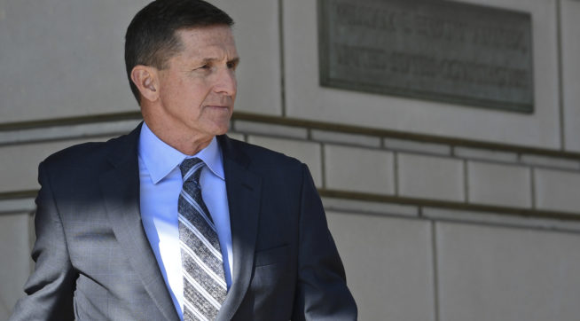 Former Trump national security adviser Michael Flynn leaves federal court in Washington, Friday, Dec. 1, 2017. (AP Photo/Susan Walsh)