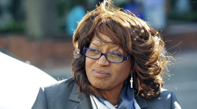 FILE  In this May 5, 2017 file photo, former U.S. Rep. Corrine Brown walks to the federal courthouse in Jacksonville, Fla., where she is expected to retake the stand in her trial on federal fraud and tax charges. Brown found guilty, Thursday, May 11, of fraudulently taking hundreds of thousands from sham charity.   (Bob Self/The Florida Times-Union via AP)